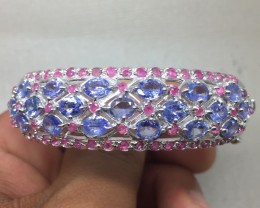 (B1) Precious Nat 129.5tcw. Tanzanite And Ruby Bangle