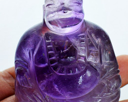 Genuine 560.00 Cts Purple Fluorite Laughing Buddha