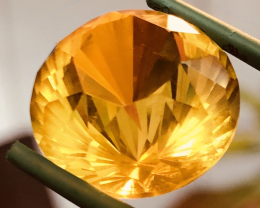 14.65 CT AMBER FACETED. MASTER CUT, BRILLIANT CUT VERY UNIQUE