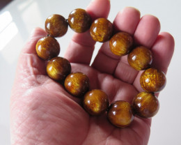 VERY NICE COPY OF GOLDEN CORAL BRACELET( streched)