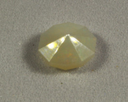 Faceted Oval milky ethiopian opal 0.6 cts. (KG22L2)