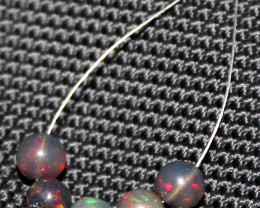 3.10 Crts Natural Ethiopian Welo Smoked Opal Balls Demi Strand 35