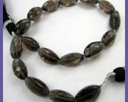 AAA GLORIOUS CARAMEL SMOKEY QUARTZ 5X9-6X13MM CARDAMON BEAD STRAND