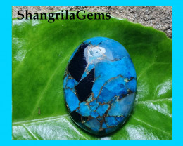27mm blue mojave calcite cabochon oval 27 by 21 by 5.5mm 27ct