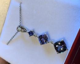 3 Ct top colour tanzanite set with diamonds and 18k white gold
