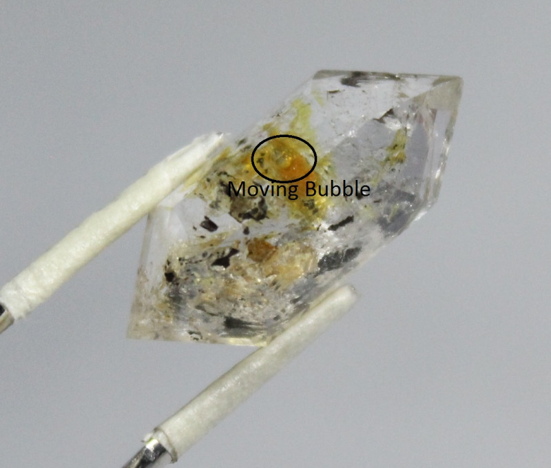 Top Class Fluorescent Petroleum Quartz With Moving Bubble on Back Side from
