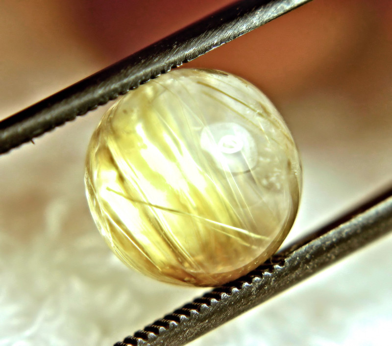 various shapes and sizes Four gold rutilated Quartz cabochons 64.12 carats total            WHGC-0082