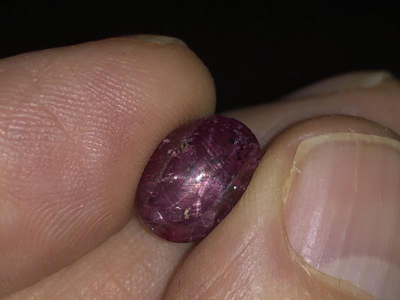Nice star pattern inside ruby cabochon.