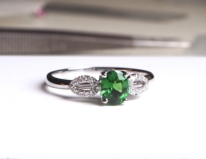 Tsavorite and diamond ring with 18k white gold