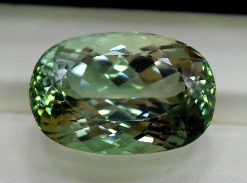 53.80 Carats Oval Cut Lush Green Spodumene Gemstone From Afghanistan