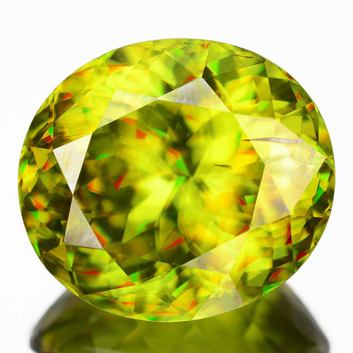 10.16 Cts Natual Honey Green Sphene with Red Sparkle Oval Cut Russia (Video