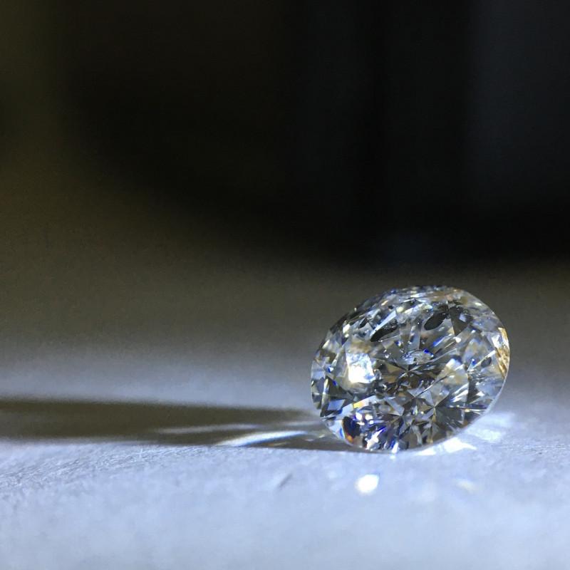0.80 carat fancy light grey I3 round brilliant diamond