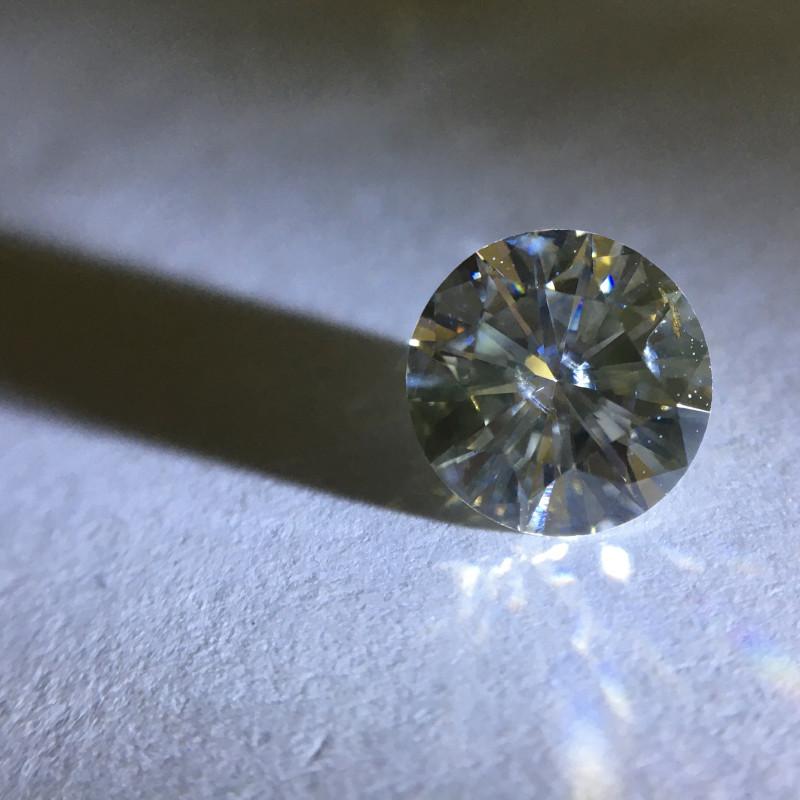 1.02 ct greenish yellow gray i2 round brilliant diamond