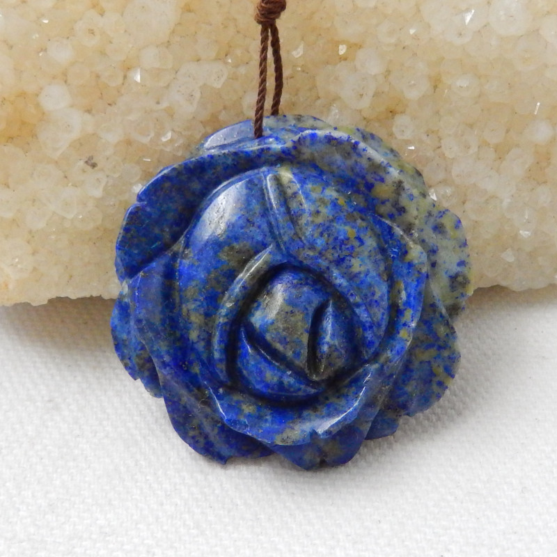 100cts Carved Lapis Flower Pendant F489