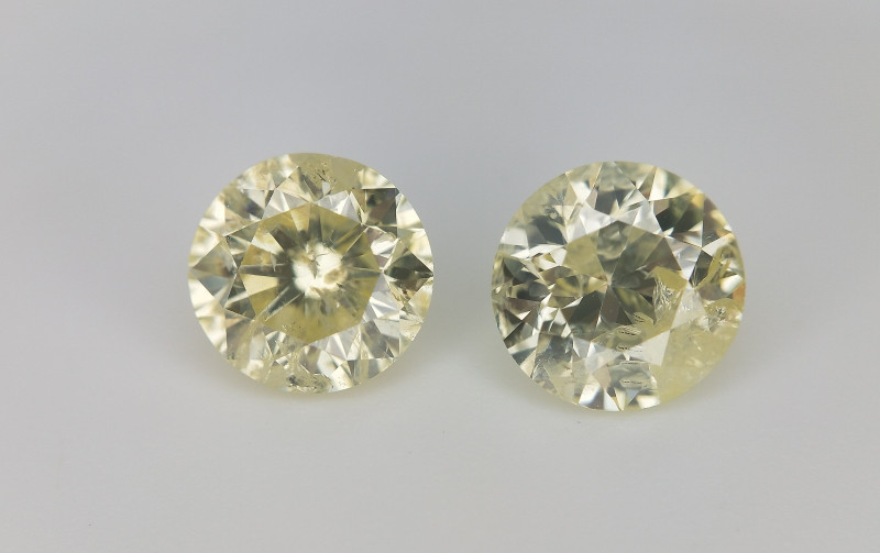 1.03 cts , Pair Of yellow Diamonds , Round Brilliant Cut
