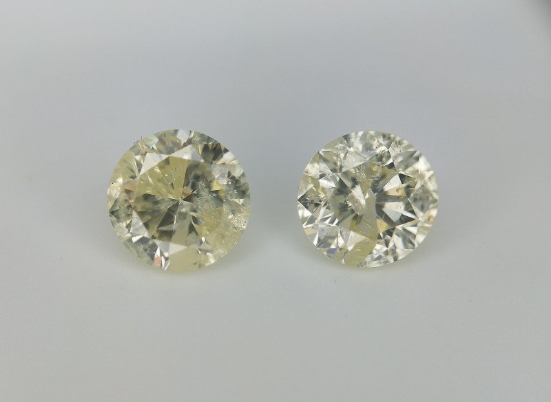 0.96 cts , Pair Of yellow Diamonds , Round Brilliant Cut