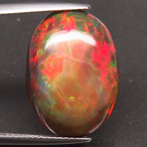 9.58  Ct. Natural Play of Color Rainbow Fire Hydrophane Opal – IGE Certific