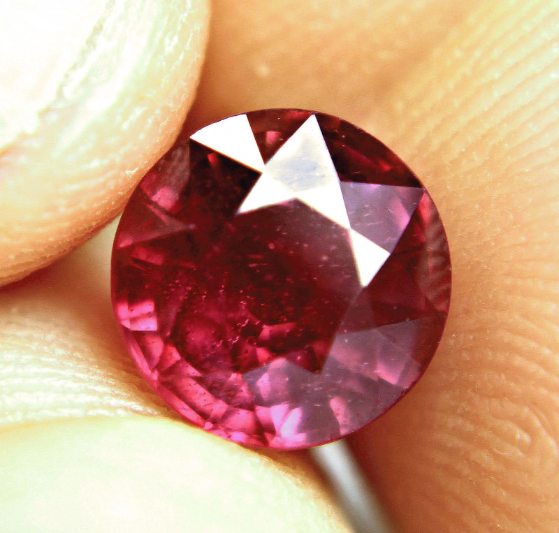 5.27 Carat Purplish Red Round Cut Ruby - Superb