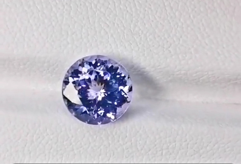 3.64cts 9mm selling at a great deal natural tanzanite only heated, internal