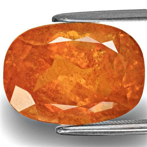 Tajikistan Clinohumite, 11.23 Carats, Rich Orange Cushion