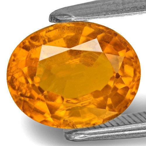 Tajikistan Clinohumite, 3.05 Carats, Vivid Yellowish Orange Oval