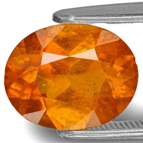 Tajikistan Clinohumite, 2.75 Carats, Bright Yellowish Orange Oval