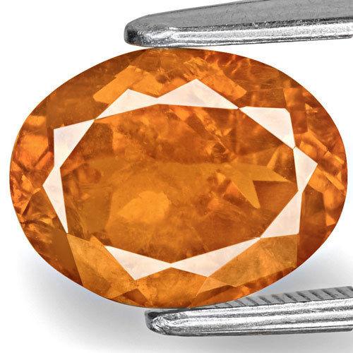 Tajikistan Clinohumite, 3.38 Carats, Fiery Deep Orange Oval