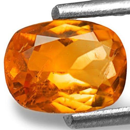 Tanzania Clinohumite, 0.82 Carats, Vivid Orange Oval