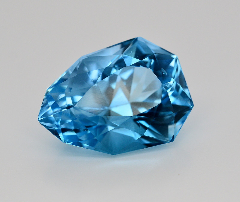 25.70 CT NATURAL BLUE SWISS TOPAZ GEMSTONE