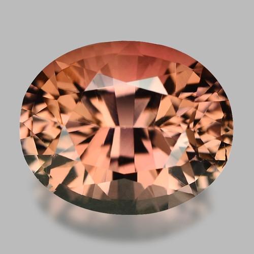 Exquisite precision cut, pinkish peach tourmaline.