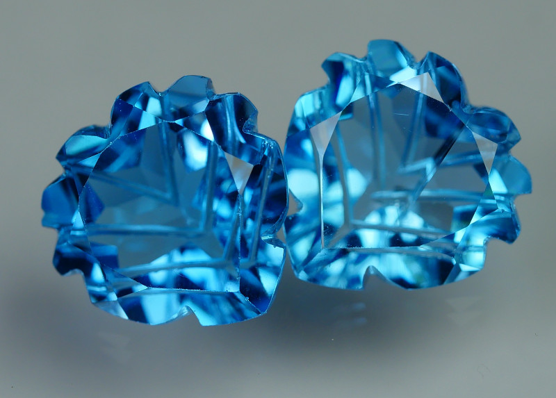 12.560 CRT LOVELY SWISS BLUE TOPAZ CARVING-