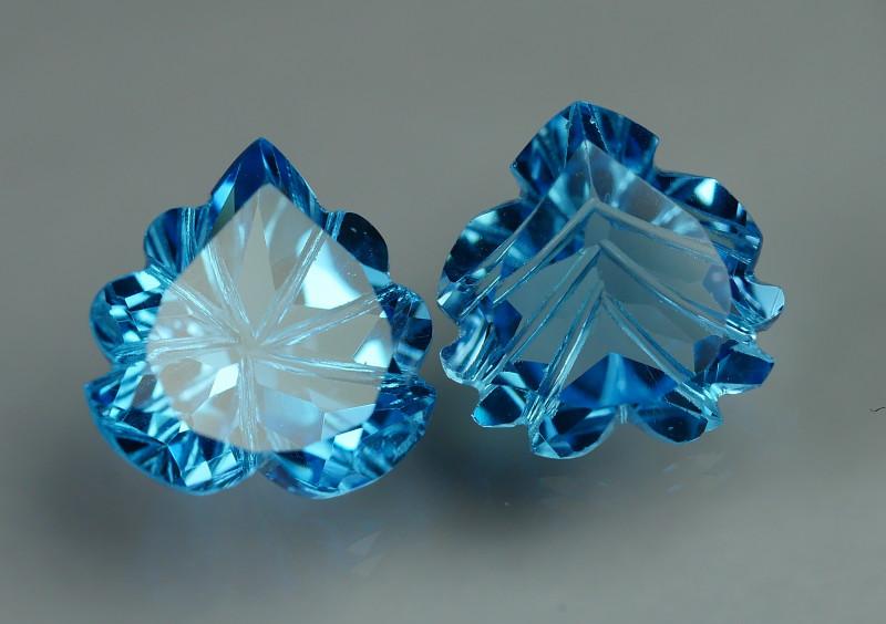 9.775 CRT LOVELY SWISS BLUE TOPAZ CARVING-