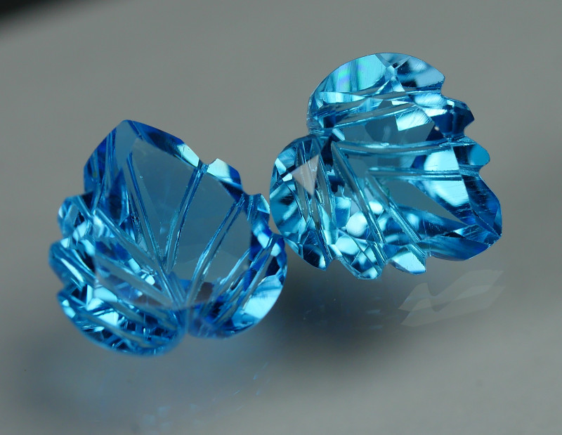 7.805 CRT LOVELY SWISS BLUE TOPAZ CARVING-