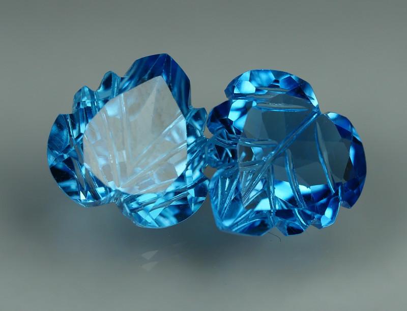 7.995 CRT LOVELY SWISS BLUE TOPAZ CARVING-