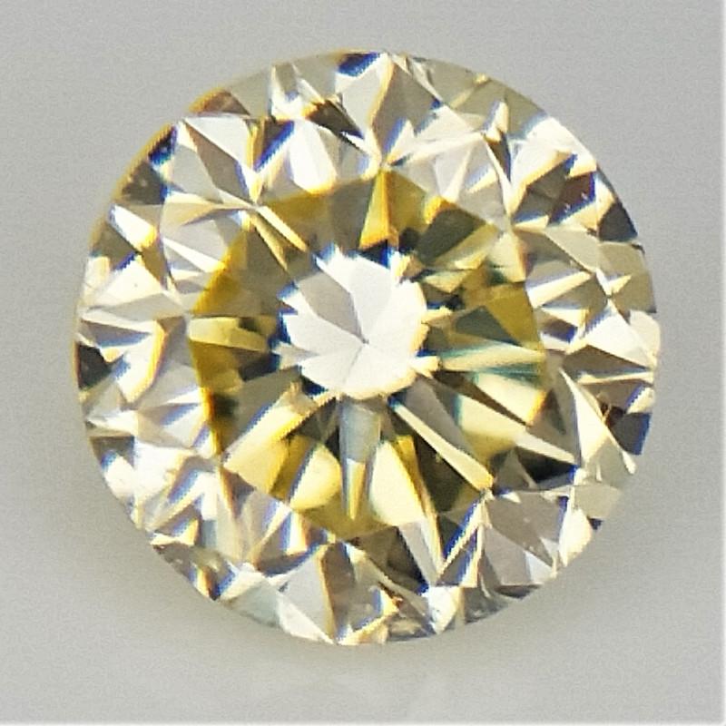 0.13 CT , Yellow color diamond , Light Color