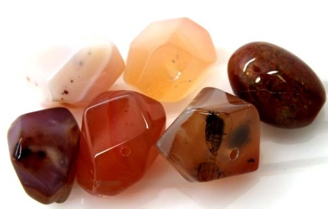 127.55 CTS CARNELIAN BEAD DRILLED (PARCEL)  ADG-156