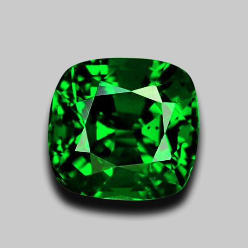 High gem quality custom cushion cut vivid green tsavorite garnet.
