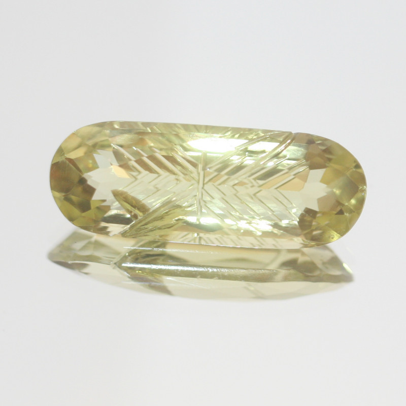 11.95 Ct Lemon Quartz Carved Oval 25x9.5mm.-(SKU 484)