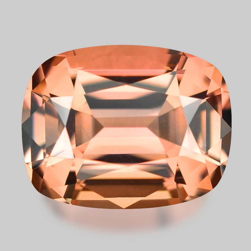 Precision custom cushion cut pinkish peach Madagascan tourmaline.