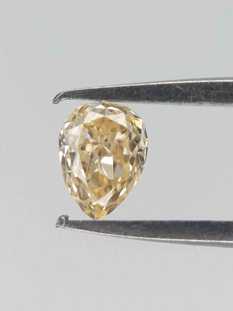 0.11 ct , Natural Yellow Diamond , Pear Briliant Cut