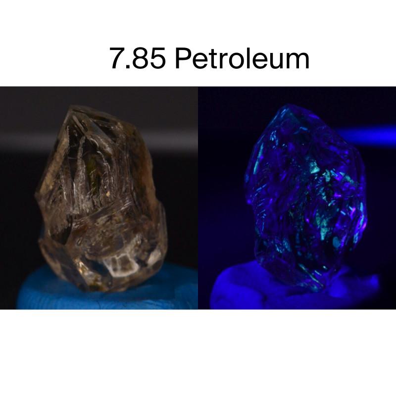 Rare 7.85 ct Natural Ancient Fluorescent Quartz With Ancient Petrolium