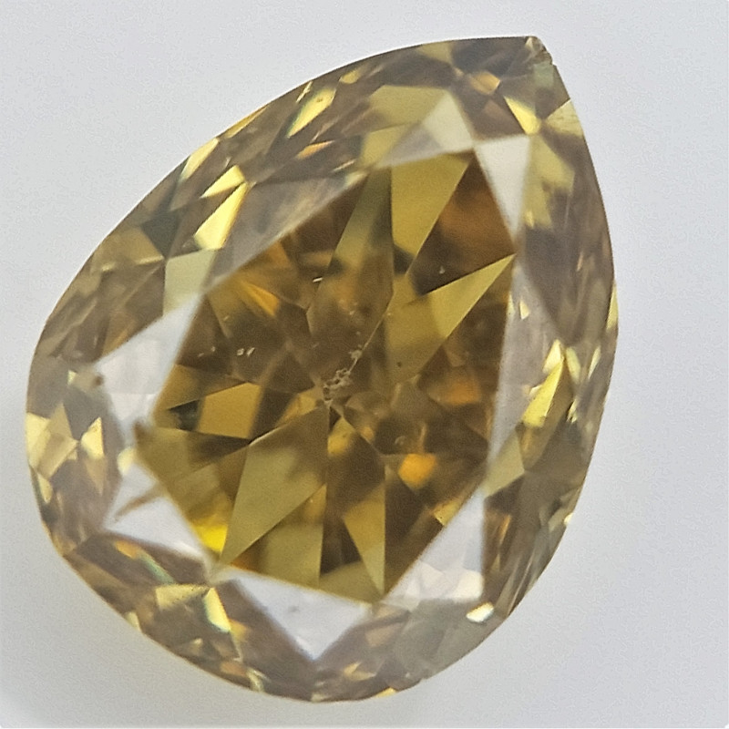 0.11 cts , Yellow Colored Diamond , Natural TearDrop Cut