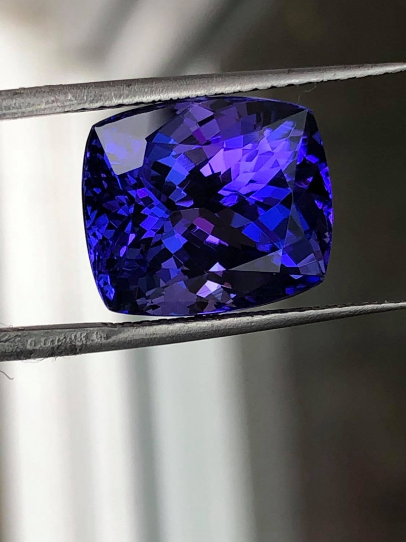 Nicely reflective clean lustrous tanzanite with an interesting color play of violet vs sapphire blue.