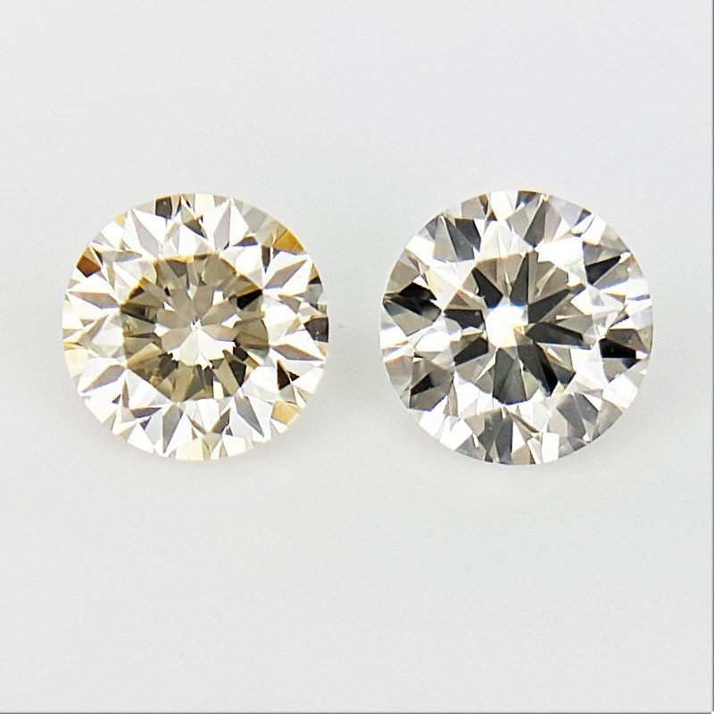0.18 CTS , Round Brilliant Cut , Light Colored Diamond