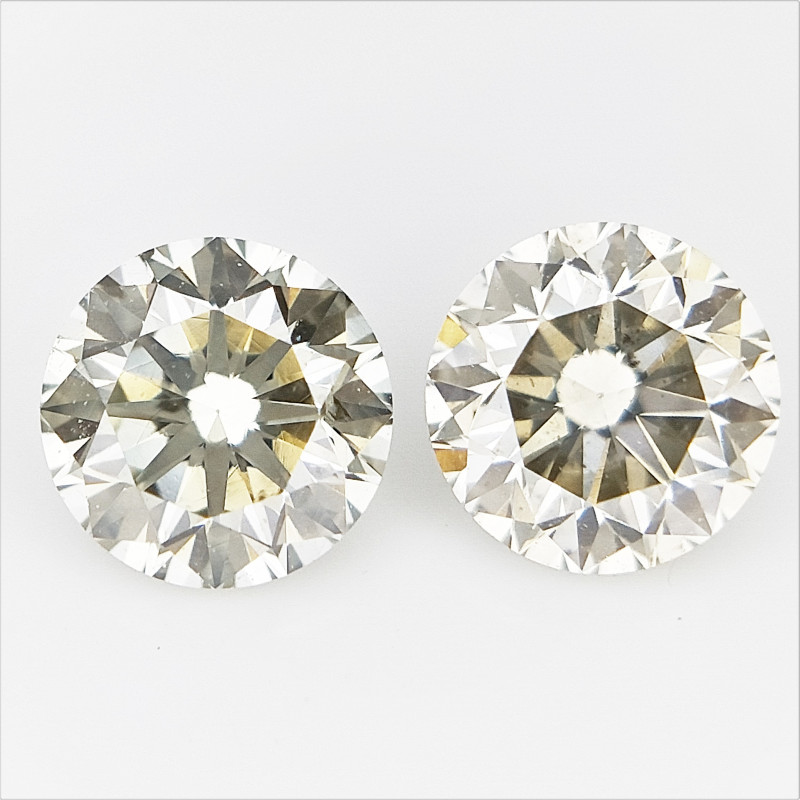 2/ 0.54 CTS , Round Brilliant Cut , Light Colored Diamond