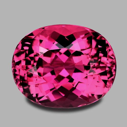 High grade, precision custom oval cut vivid pink Brazilian tourmaline.