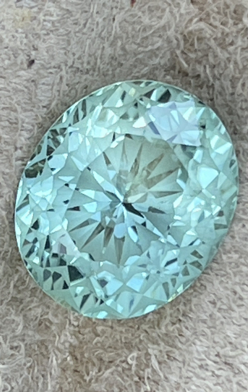 Look at this for cutting!  I found a new cutter and he is the best!  True master cutting.  Gorgeous bluish green color.   Look more paraiba blue to me.  Don't believe these certificates that say Paraiba unless it is GIA or GRS. This lab is honest and told
