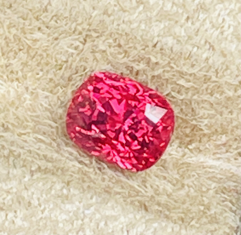 Gorgeous pinkish red color.   Very bright reflective stone.  One of the prettiest colors!   More pretty than just plain red I think.   More brighter.