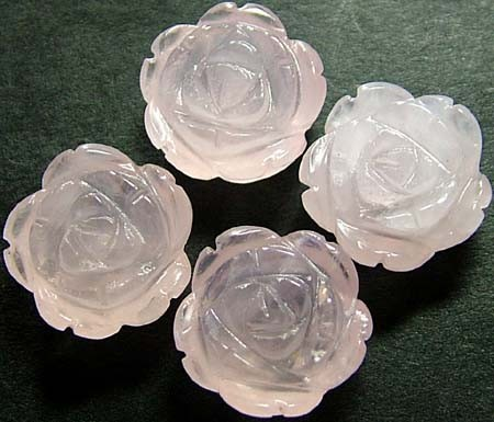 FOUR ROSE QUARTZ FLOWER CARVINGS DRILLED  47.35 CTS [MX4238]