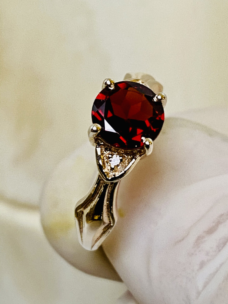 RED GARNET RING WITH SILVER  , FROM COLLECTOR- UNUSED!